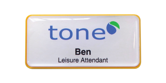 H45 robust yellow frame namebadge dome printed by Fattorini 75 x 35mm