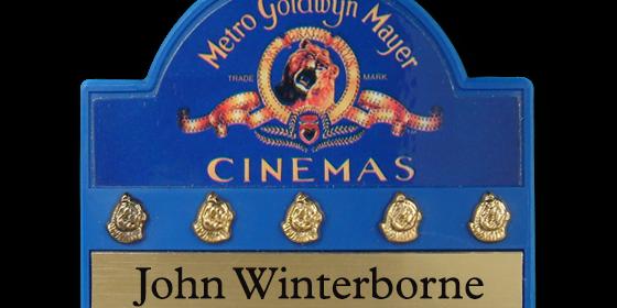 MX5 blue plastic name badge by Fattorini bespoke shape