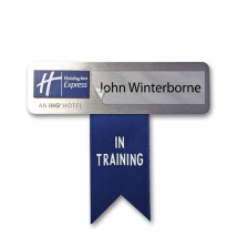 """Name badge with """"in training"""" ribbon"""