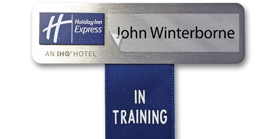 "Name badge with ""in training"" ribbon"