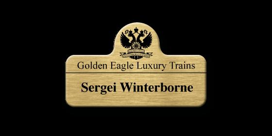 PX2 brushed gold metal panel name badge by Fattorini bespoke shape